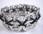L Poppy Toppy 26 Tab Bracelet in Black - size Large - Donation made to Ronald McDonald house with your purchase