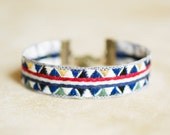 LAND reversible stack bracelet made from blue or red triangle / arrow motif ribbon