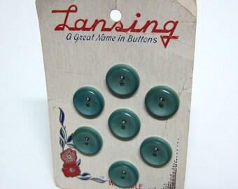 7 seafoam green buttons