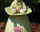 Mr.TEDDY riding high...Green Recycled Glass Garden or YARD DECORATION