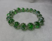 """Green Faceted Crystal Glass With Silvery Flower Cap Stretchy Beaded Bracelet 7""""L"""