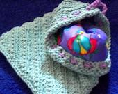 Small, handknit, lined, drawstring bag