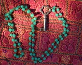 Mysterious antique key on a rope  of jade green