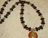 Black, Gold and Amber Beaded Necklace with Lampwork Drop