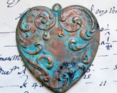 Domed heart pendant, hand torched and hand patinated