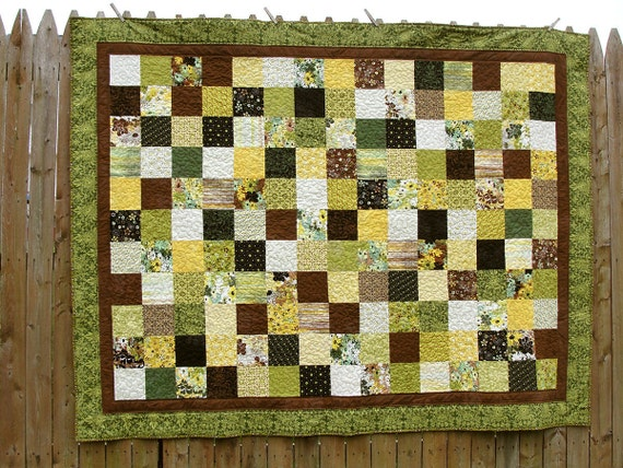 """Twin or throw sized quilt in """"Origins"""" material - brown and green"""