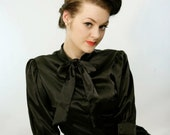 1940's black satin elegant secretary blouse with puffed sleeves and a bow tie.
