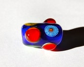 handmade blue glass lampwork focal bead with red raised dots