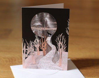 Wolf howling at moon blank greeting card papercut altered book sculpture.