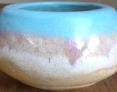 Stoneware pot with blue, orchid, white and tan glazes