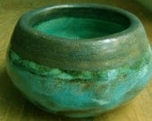 Stoneware pot with blue and gold glazes
