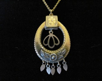 Lovely gold Vintage Victorian pendant and chain with floral accents in silver steampunk style