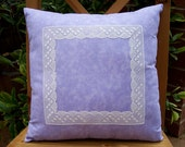 lace decorated throw pillow