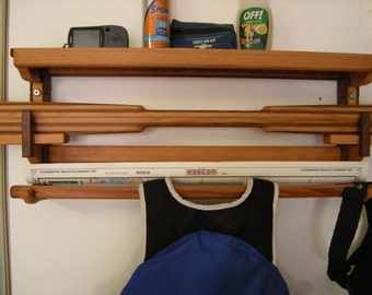 Paddle Storage, Douglas Fir, Redwood and Black Walnut . Removable PFD hanger and top tray shelf.