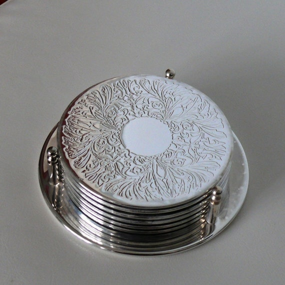 Vintage English Silver Plated Coaster Set with a Storage Caddy / Deeply - Engraved design