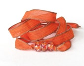 Bohemian silk wrap bracelet in burnt orange with hand dyed silk ribbon and Pandora style glass beads