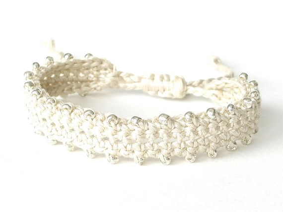 Cream white friendship bracelet, beaded and crocheted with adjustable knot & silver plated heart tag 'Made with Love'