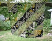 Geometric squares quilted wall hanging (green, yellow, black, white)