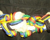 1980's braided belt in multi colors has velco closure 38 inches laid out