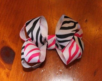Twisted style hair bow with 2 zebra prints