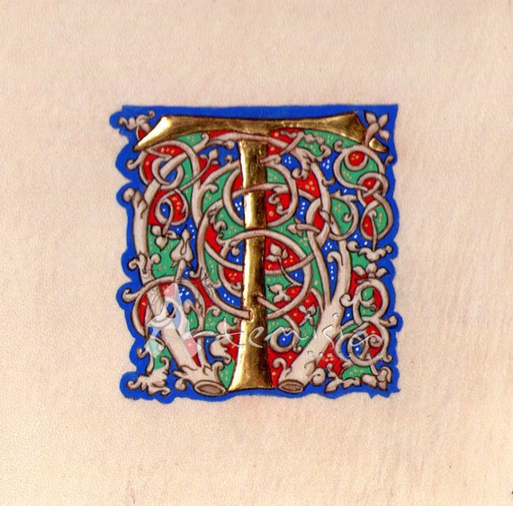 Illuminated letter T on parchment  - gold leaf and egg tempera -