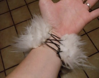White Furry cuff that laces up
