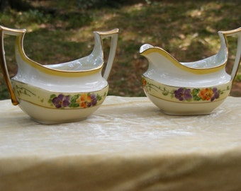beautiful antique china gold rimmed floral        Hutshenreuther       cream and sugar set