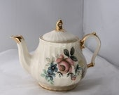 Vintage bone china teapot with gold gilt and floral painted design