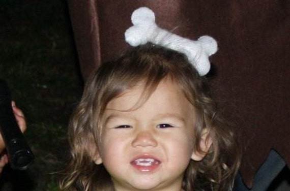 bone hair clip cave girl pebbles