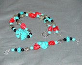 Southwestern Blue and Red Turquoise Bracelet Laced with Onyx and Silver Spacers