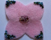 Pale pink felted broach with beading embelishment