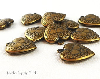Large puffy heart brass ox (x4)