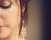 tallulah.  a pair of beaded wooden leaf earrings.