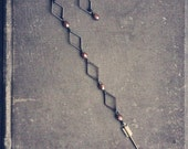 arizona. a pair of asymmetrical copper & arrow earrings.