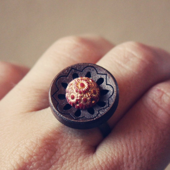 ade.  a wooden cutout ring with hints of sparkle.