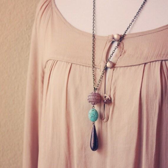 dali.  an earthy beaded teardrop necklace.