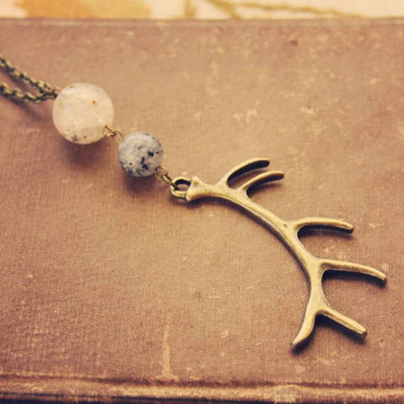 tivah.  a long beaded brass antler necklace.