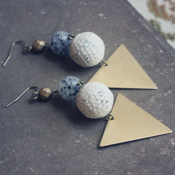 venus. a pair of black and white geometric brass triangle earrings.
