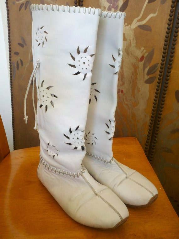 white leather minnetonka style moccasin boots