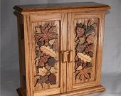 Necklace cabinet made in Red Oak