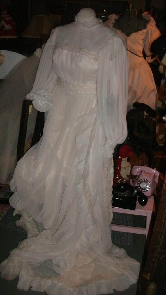 Vintage 1970s wedding dress with veil