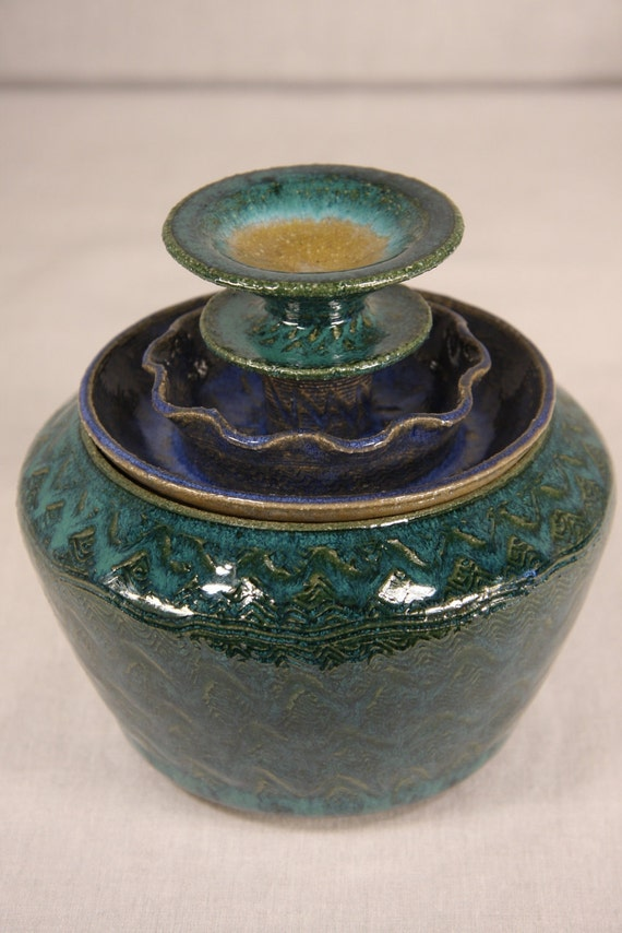 Ceramic jar lidded 4 tiers in peacock green, sapphire blue and sunshine yellow