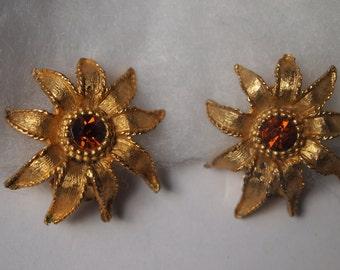 Vintage gold tone, textured Sunburst Flower clip on earrings.  Costume Jewelry