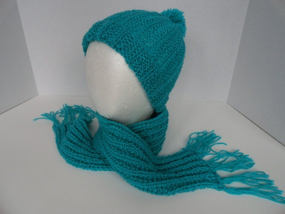 Child's Knitted Winter Teal Hat with Pom Pom and Fringed Scarf.