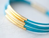 Reserved for Natalie: Turquoise Leather Bracelet with Golden tubes by pardes israel