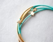 Mint Green Leather Bracelet with Mat Golden Small Stars and Tubes by pardes israel