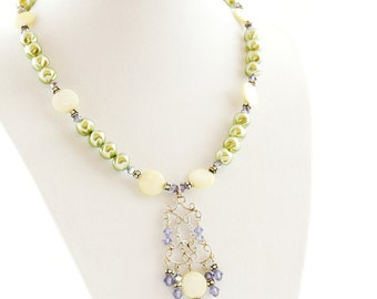 beautiful vintage handcrafted necklace with mother of pearl and sterling sliver and green faux pearls