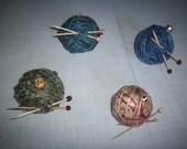 Yarn ornaments with knitting needles