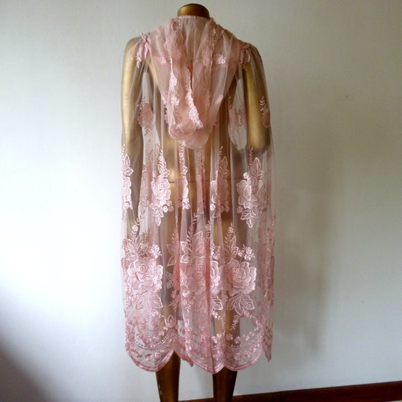 Lace evening cape with hood.