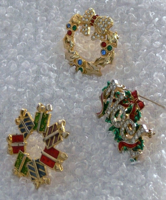 Christmas Brooches signed